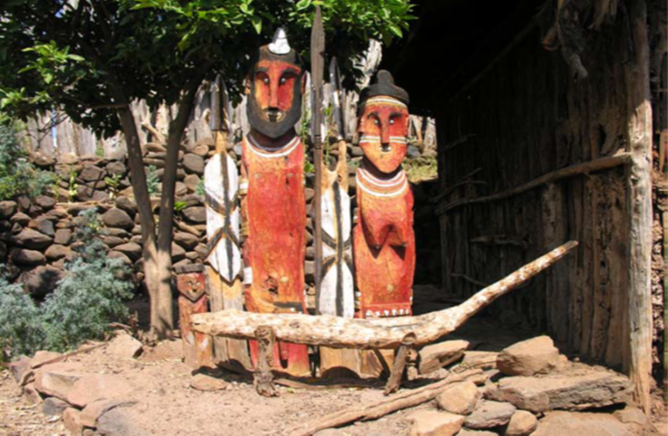 Poqola Bamale and his wife's Wakas placed in their residence; (source: Konso Cultural Landscape nomination file